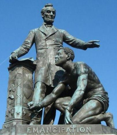 Abraham Lincoln standing above crouched slave wearing manacles